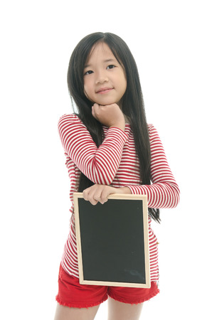 Beautiful asian girl holding chalk board on white background isolated photo