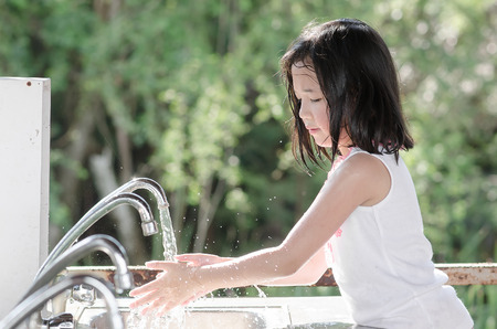 hand washing: Little beautiful asian girl washing hand Stock Photo