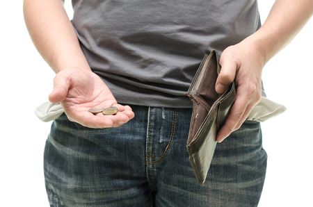 impoverished: Coins in hand with empty pocket,blue jean with white background