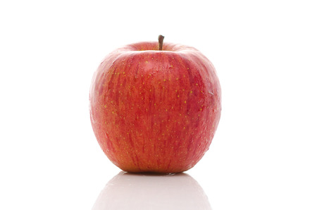 Close up of red apple on white background isolated