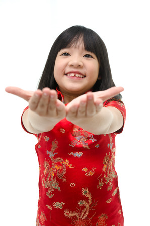 smile please: Little asian girl begging on white background isolated Stock Photo