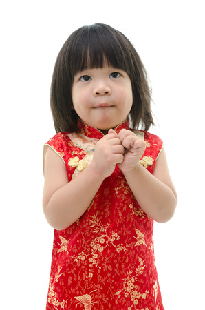 smile please: Little asian baby begging on white background isolated