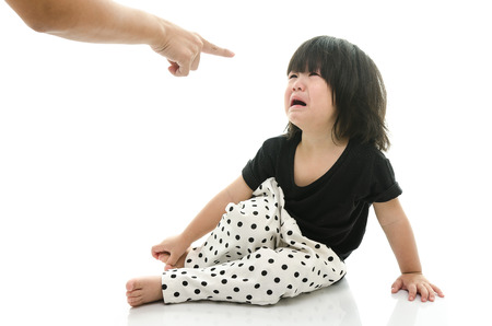 Asian baby crying while mother scolding on white background isolated Standard-Bild