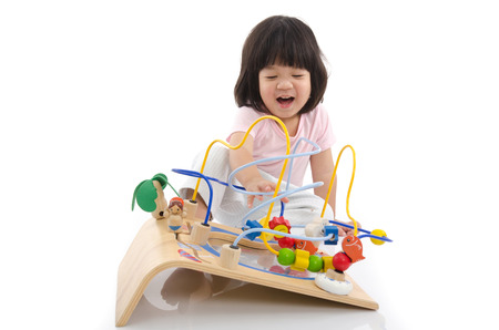 Asian baby playing education toy on white back ground isolated