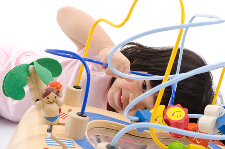 asian baby girl: Asian baby playing education toy on white back ground isolated