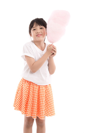 Cute asian girl holding pink cotton candy on white background isolated