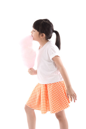 cotton candy: Cute asian girl holding pink cotton candy on white background isolated