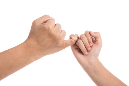 Mother and daughter making a pinkie promise isolated on white background.