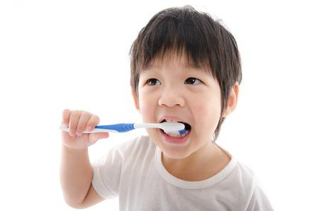 Cute asian bay brushing teeth on white background isolated Stock Photo