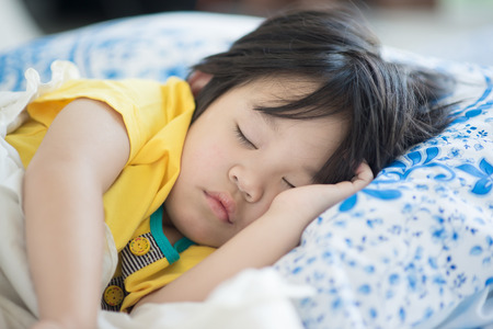 kid portrait: Cute asian baby sleeping on bed Stock Photo