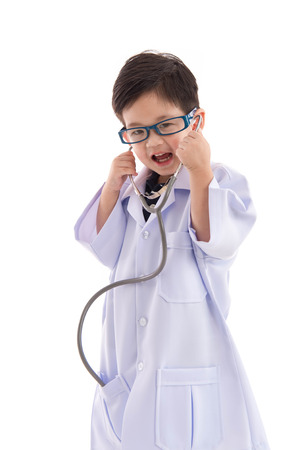 doctor care: Cute asian child in a doctors uniform on white background isolated with copy space