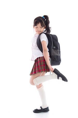 Portrait of asian child in school uniform on white background isolated Stock Photo