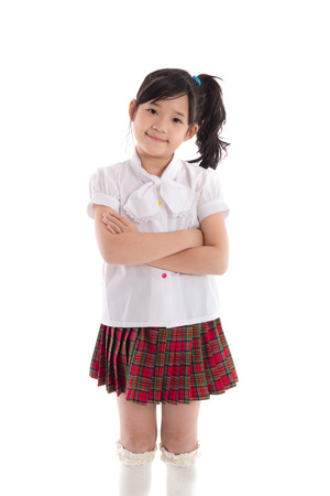 Portrait of asian child in school uniform on white background isolated Standard-Bild