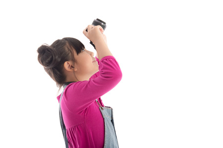 studio happy overall: Cute asian girl holding  camera on white background isolated