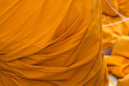 monk robe: Close up of yellow robe of Buddhist monk pattern background