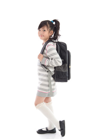 Beautiful asian school girl with backpack on white background isolated