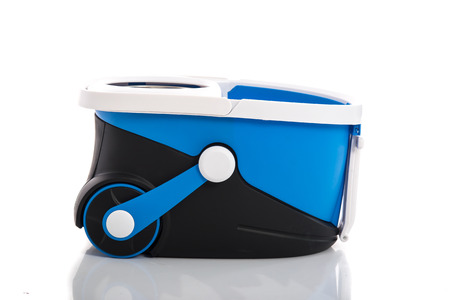 broom handle: blue bucket isolated on white background Stock Photo