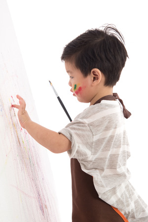 Cute little asian boy painting isolated on white background