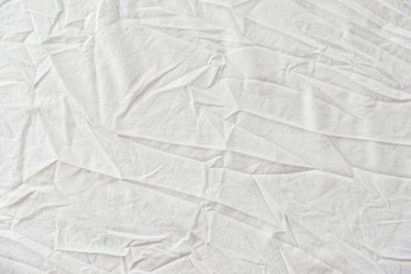 白背景の生地テクスチャのしわ 写真素材