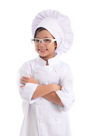 young girl: Little asian girl chef in uniform wearing glasses isolated on white background Stock Photo