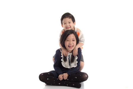 korea girl: Cute asian child hugging his sister on white background isolated