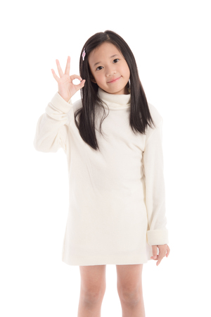 turtleneck: Cute asian girl in white turtleneck dress showing ok sign,white background isolated