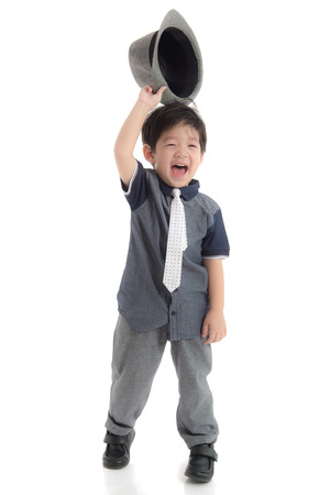 hi hat: Happy asian boy holding a hat on white background isolated Stock Photo