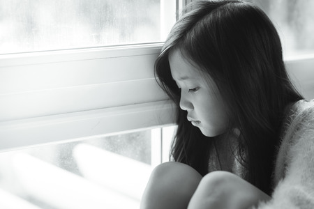 girl portrait: Portrait of asian beautiful sad girl at the window,vintage filter