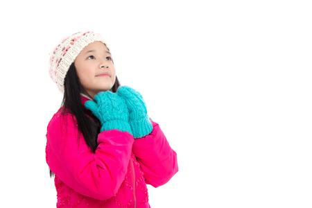 cold background: Beautiul asian girl in colorful winter clothes on white background isolated Stock Photo