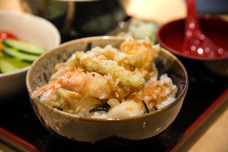 tendon: tempura served over a bowl of rice,Tendon