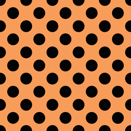 tiny: Tiny Black polka dots on orange background Stock Photo