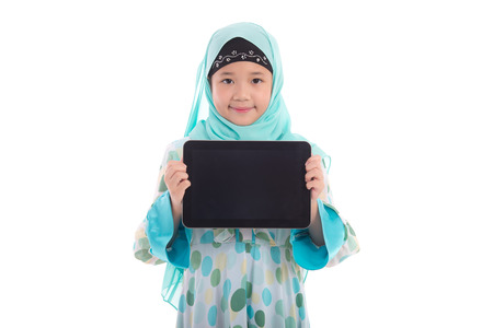 Asian muslim girl holding tablet on white background isolated