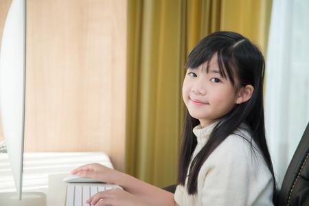Beautiful asian girl using computer