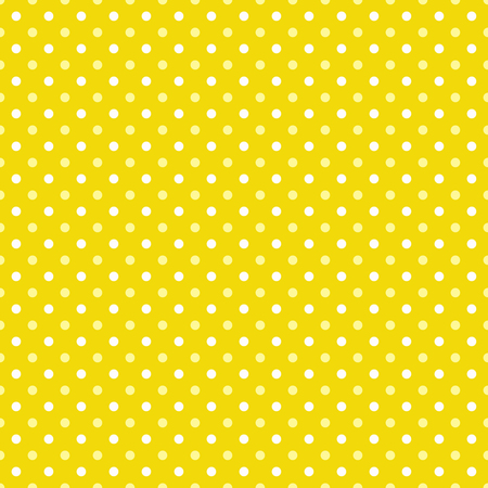 White and yellow polka dots on yellow background