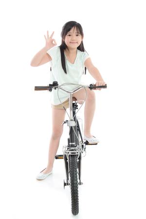 Asian Girl On Bike