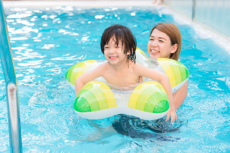 hot asian: Asian Mother and son playing in swimming pool