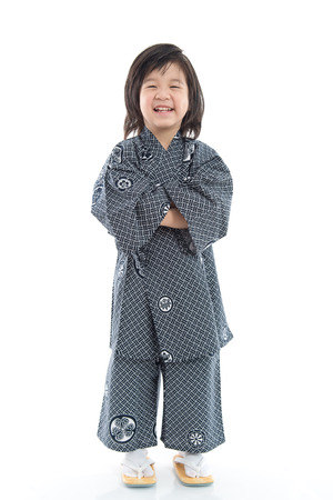 Happy asian boy in kimono on white background isolated Stock Photo