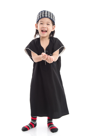 Cute muslim chlid on white background isolated.