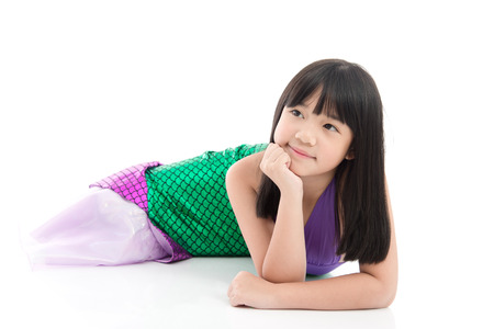 Beautiful Asian girl in fantasy mermaid costume on white background isolated