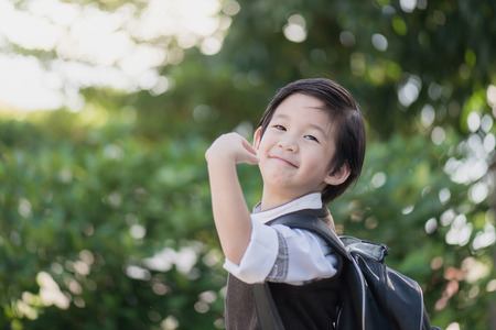 Portrait of Asian student with backpack outdoors,back to school concept 版權商用圖片 - 61507637