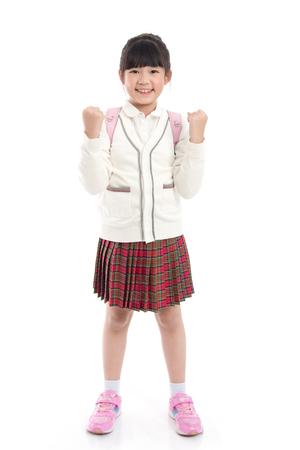 分離した白地にピンクのランドセルに制服でアジアの子