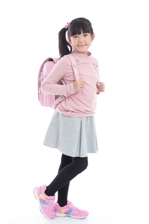 Asian schoolgirl with pink school bag on white background isolated
