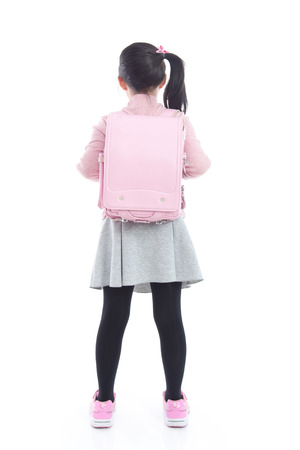 Back of Asian schoolgirl with pink school bag on white background isolated Stock Photo