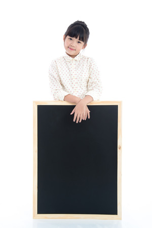 white poster: Beautiful Asian girl with black board on white background isolated Stock Photo