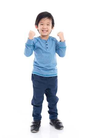 hurray: Cute Asian child showing winner sign on white background isolated