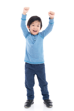 Cute Asian child showing winner sign on white background isolated Stok Fotoğraf - 72249781