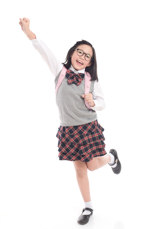 Asian child in school uniform winner sign on white background isolated