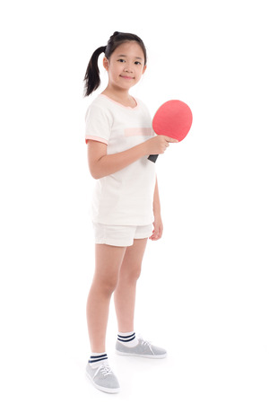 Beautiful Asian girl  playing table tennis on white background isolated Banco de Imagens