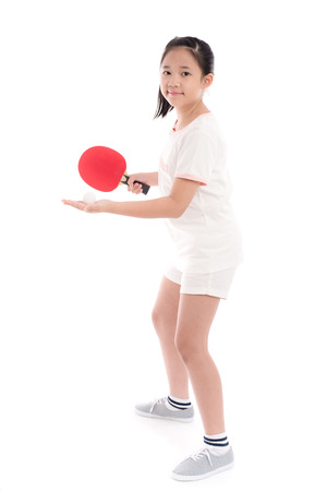 Beautiful Asian girl  playing table tennis on white background isolated Foto de archivo