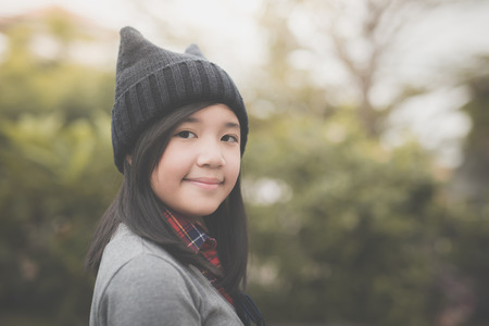 Portrait of cute Asian girl in the park Stock Photo